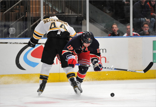 Brad Richards of the Rangers got checked by Dennis Seidenberg of the Bruins.