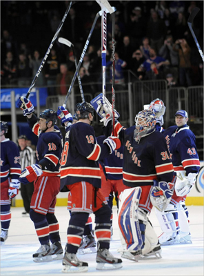 New York Rangers saluted the fans after defeating the Boston Bruins 4-3 in an NHL hockey game Sunday, March 4, at Madison Square Garden in New York.
