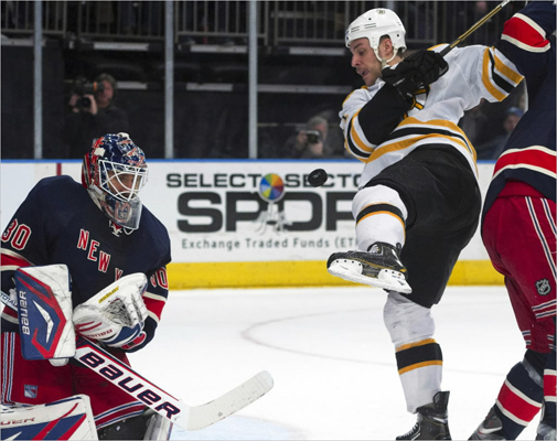 Rangers goaltender Henrik Lundqvist (30) made a save as Bruins center Gregory Campbell (11) tried to get the rebound in the first period.