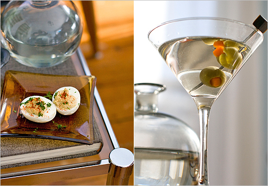 A classic martini made with gin and vermouth and a plate of deviled eggs.