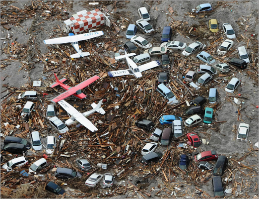 March 11, 2011 Light planes and vehicles were among the debris at Sendai airport in northern Japan. The 13-foot tsunami swept boats, cars, buildings, and tons of debris miles inland.