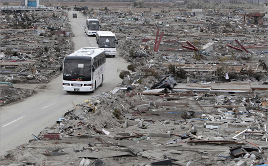March 21, 2011 Buses took residents on a tour through their devastated suburb in Natori, Miyagi Prefecture, Japan.