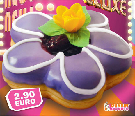 Germany - Dunkin' Deluxe donuts In Germany, there are special premium Dunkin' Deluxe donuts which have a flower design. Their flavors include Chocolate Walnut Creme, Cherry Vanilla Creme, Black Raspberry (pictured), Orange Creme Chocolate, and Apple Chocolate. Are you into Deluxe donuts?