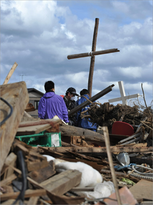 May 3, 2011 Volunteers cleared rubble around the Kesennuma Daiichi Bible Baptist Church in the devastated city of Kesennuma, Miyagi prefecture, in northeastern Japan. The estimate as of May was 26,000 dead or missing in obliterated towns and villages on the northeast coast.