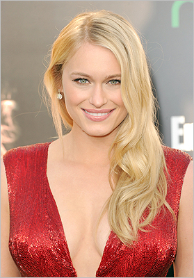 Hollywood waves Actress Leven Rambin at the premiere of 'The Hunger Games' at Nokia Theatre L.A. Live on March 12.