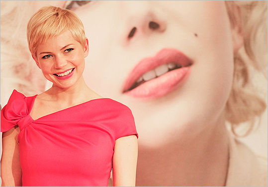 A page from the boys A clean, closely cropped, well coiffed cut that would have made Mia Farrow proud. Pictured: Actress Michelle Williams at the 'My Week with Marilyn' press conference at the Imperial Hotel on March 14 in Tokyo.