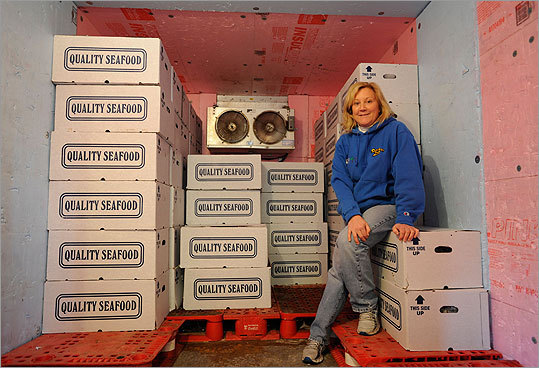 Betsey Brewer, executive of the Southwick Zoo sat in the zoo's freezer in Mendon, Mass.