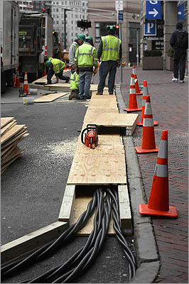 Utility workers on Huntington Ave near Copley Place continued to restore electricity after a transformer fire earlier this week caused a power outage in Boston.