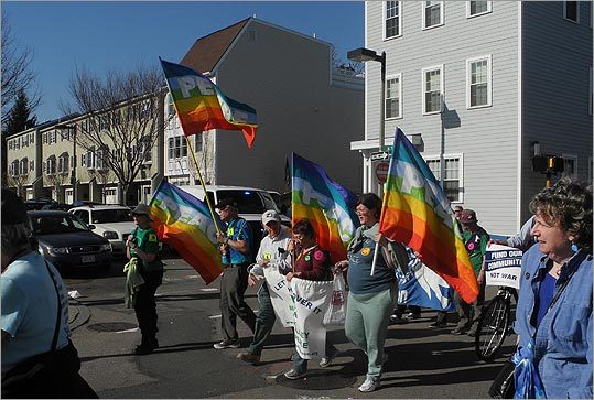 A group waved rainbow 'Peace' flags.