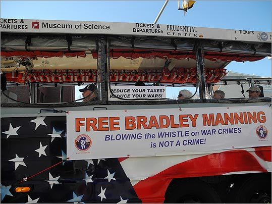 "A duck boat decorated with a sign that read ""Free Bradley Manning"" — an Army private accused of leaking hundreds of thousands of pages of classified information."