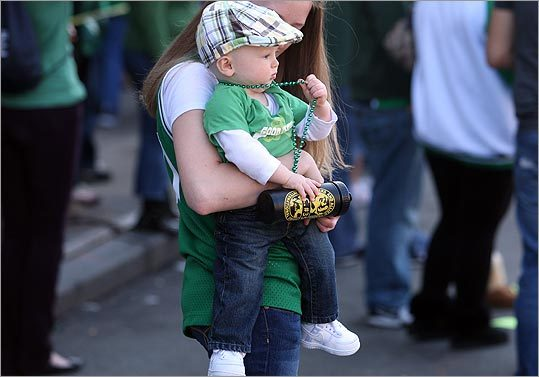 Jennifer Williams held her son Donald Hatem while they watched the parade.