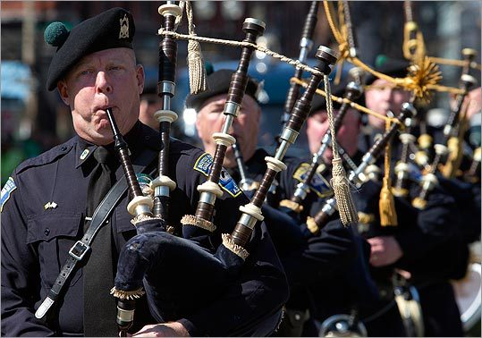 The Boston Police Gaelic Column played bagpipes while they walked in the parade.