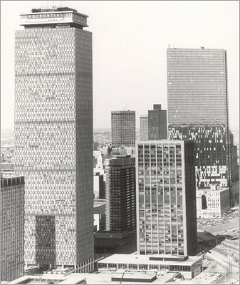 John Hancock Tower After delaying its opening from 1971 to 1976, the John Hancock Tower certainly went through its tough times. During construction, the building lost entire window panes that would detach from the building and crash onto the sidewalk below. The Hancock is in the right background of the photo. Picture taken 1973
