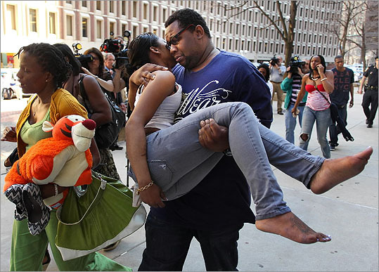 A woman was carried out of the courthouse by a man crying, as other relatives carried her belongings.