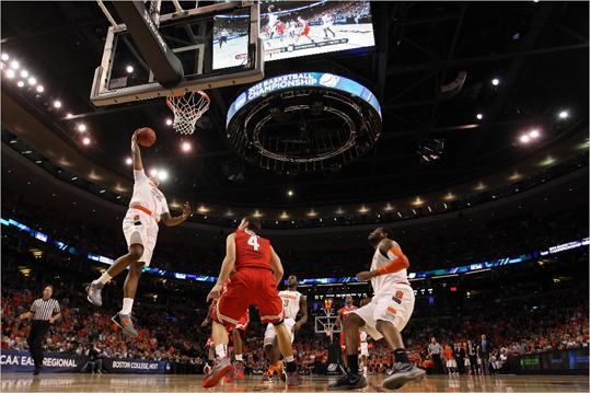 Kris Joseph of the Syracuse Orange went to the hoop against Aaron Craft (4) of the Ohio State Buckeyes.