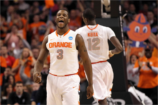 Dion Waiters (3) of the Syracuse Orange reacted after a basket against the Ohio State Buckeyes.