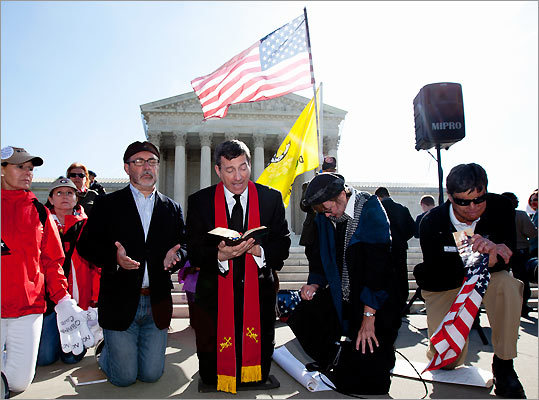 From left: Janis Haddon, of Atlanta, Rev. Patrick J. Mahoney, director of the Christian Defense Coaltion, Rev. Rob Schenck, president of the National Clergy Council, Linda Door of Laguna Beach, Calif., and Ken Campbell, of the Tea Party Patriots, prayed in front of the Supreme Court in Washington on March 28