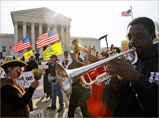 Jonathan Neal, a senior at Howard University, played his trumpet in support of health care reform in front of the Supreme Court on March 28
