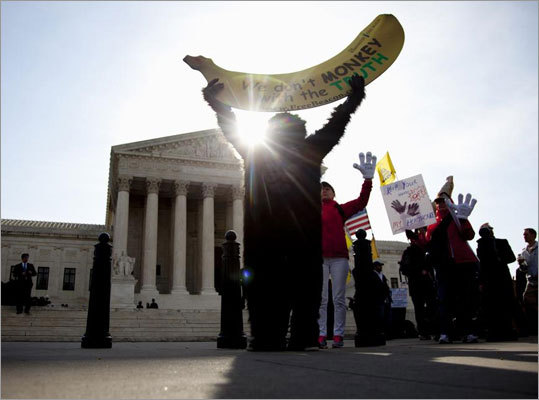 Protesters gathered in front of the the Supreme Court on Wednesday as the justices concluded three days of hearing arguments on the constitutionality of the health care overhaul.