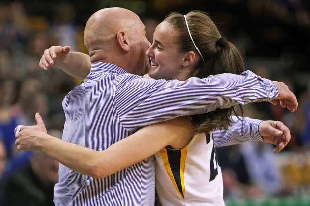 Boudreau embraced Andover coach Jim Tildsley after the Golden Warriors won the EMass championship.