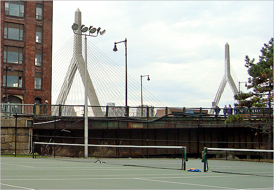 North End (605 Commercial St.) These courts offer a perfect blend of Boston's breathtaking scenery and your tennis adrenaline. Though somewhat hidden underneath the Charlestown Bridge , the courts peacefully lie by the waterfront and offer another angled view of the TD Garden . On a nice summer night, when you're lucky enough to catch the night lights on, playing with a buddy can actually be a refreshing activity.