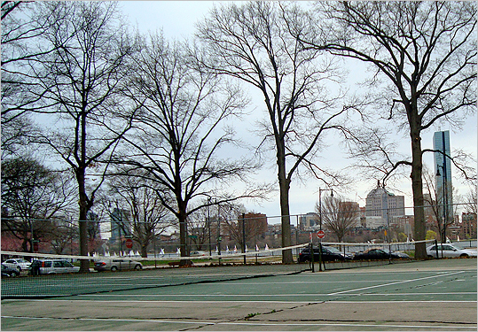 Saxon Tennis Court at MIT (6 Ames St.) Located right next to the Charles near the MIT sailing pavilion , these courts offer a romantic view of Boston from the other side of the river . There are four courts available, so the wait is not usually too bad. However, the current conditions are not ideal for any competitive matches: After a long, abandoned winter, the cracks in the ground and the big holes in the nets will prevent your sterling skills from seeing their glorious days.