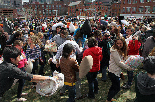 Hundreds of students, families, and interested onlookers turned out Saturday afternoon for Banditos Misteriosos' 2012 Pillow Fight in the North End Park. Part of the International Pillow Fight Day, Saturday's rumble pitted residents head to head with their featherless weapons swinging and ducking.