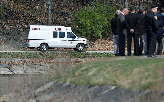 A medical examiner's van arrived at the Chestnut Hill Reservoir, where the body was found.