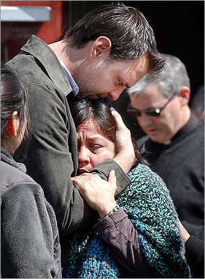 Luzmila Garcia (center) was consoled after the body of her missing son Franco was pulled from the reservoir.