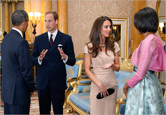 With the president and Michelle Obama at Buckingham Palace on May 24, 2011. Fashion fans watched as the duchess and first lady measured up as their respective country's stylish leaders. In this photo of an early daytime meeting, Michelle wore a jacquard dress and bolero by California designer Barbara Tfank while Catherine opted for a nude sheath by British designer Reiss. Read the story .