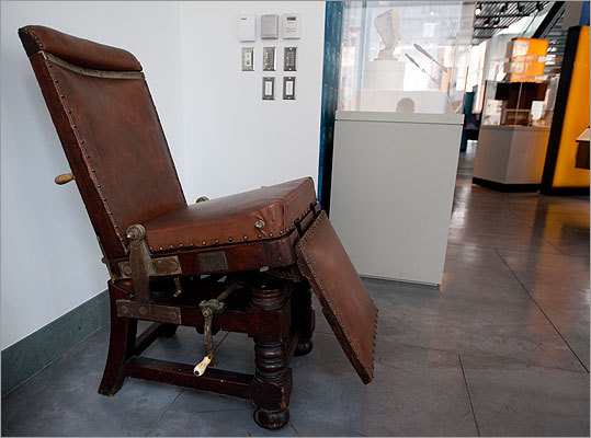 This surgical operating chair was invented by Dr. Henry J. Bigelow (1818–1890), a distinguished surgeon at MGH and a professor of surgery at Harvard Medical School. The Bigelow Chair features a reclining back, movable leg extension and leather upholstery, with each section mobile with the ivory and wooden handles to enable a surgeon to properly position the patient. In the early 1800s, operating chairs and tables were made of wood and featured several restraints to hold patients securely in place while a surgeon worked. In the later part of the century, restraints were no longer needed following the introduction of ether anesthesia in 1846, and the chairs reverted to the earlier, simpler style in the aseptic era – instead of plush leather or padding they were made of metal so they could easily be sterilized.