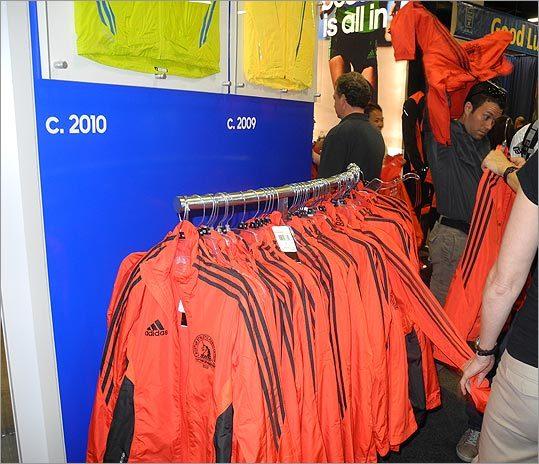 Runners picked up orange Boston Marathon 2012 jackets.