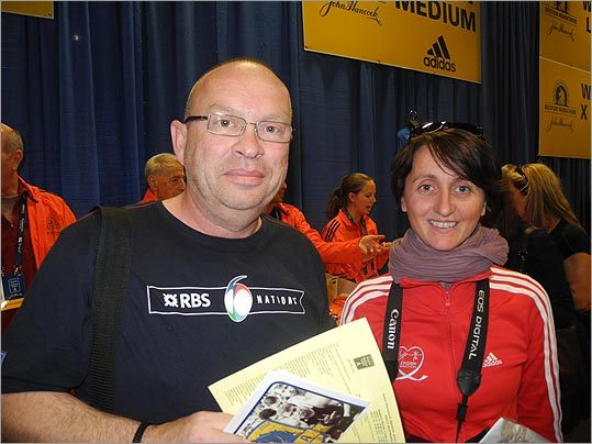 Thierry De La Croix (left) and Frederique Neusch, both of France, are in Boston for just a few days to run the marathon together.