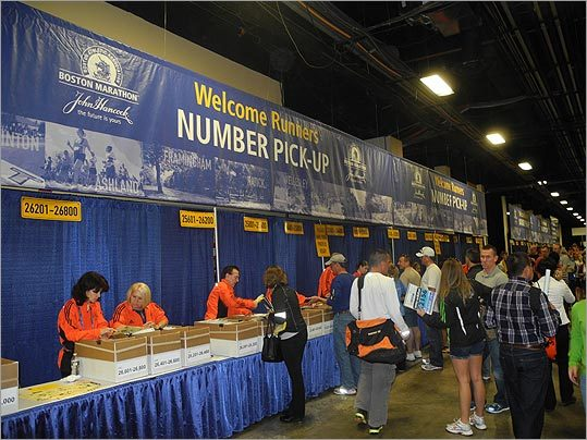 Along the side of the convention were stations where runners could pick up their marathon numbers.