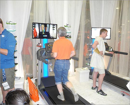 A man tries out the running gait analysis, where subjects are recorded running barefoot and then the tape is played back in slow motion, in order to determine how much support you need in a shoe.