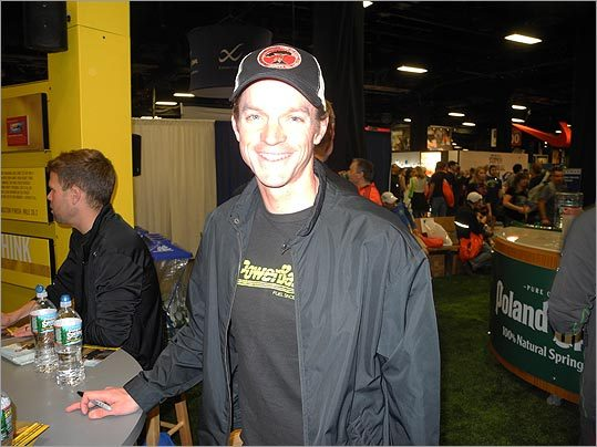 Tim DeBoom, two-time Ironman world champion, signed autographs at the Powerbar booth with Josh Cox, the 5K American record holder.