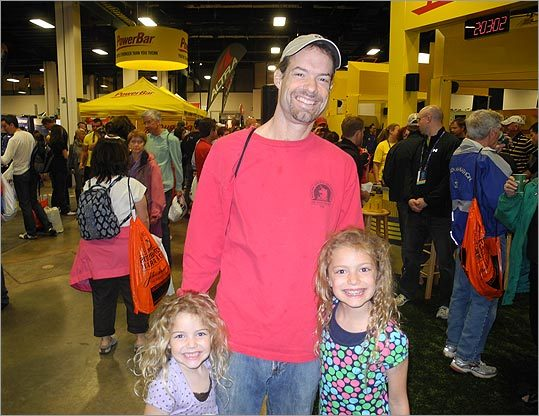 Todd Juenger, of Irvinton, N.Y., with his daughters Lila, 6 (left), and Emmy, 8, is running his seventh Boston Marathon, and 16th marathon ever. 'I'm nervous about how hot it's going to be,' he said, adding that Boston is his favorite marathon. 'As long as I'm able to keep qualifying we'll keep coming back.'