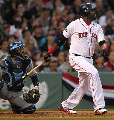Red Sox designated hitter David Ortiz stroked a bases loaded double that cleared the bases in the eighth inning.