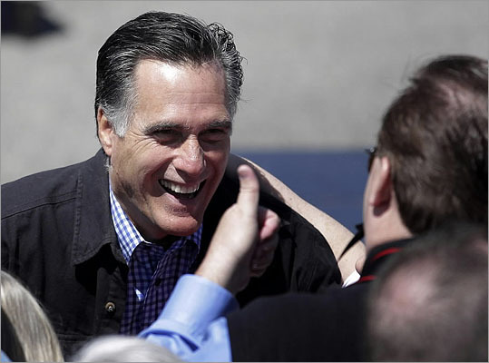 Republican presidential candidate Mitt Romney greeted supporters at the Portsmouth Fish Pier in Portsmouth, N.H., on Monday. Click through to see more photos of Romney campaigning in New Hampshire.