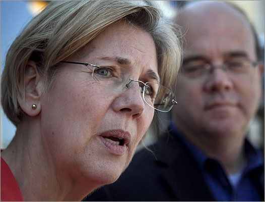 Democratic candidate for U.S. Senate Elizabeth Warren faced reporters during a campaign stop at a diner in Shrewsbury, Mass., April 29, as U.S. Rep. Jim McGovern, D-Mass., looked on.