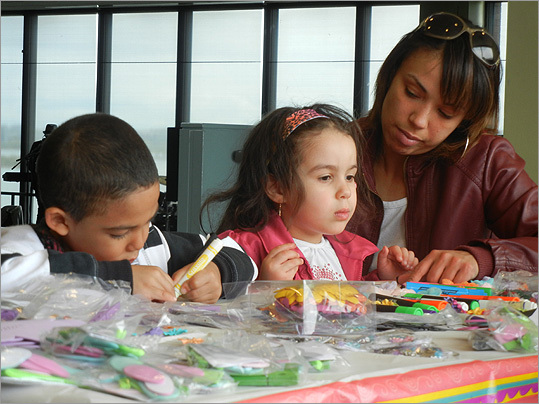 The arts and crafts table occupied the children.