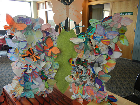 Chelsea High School juniors contributed their own decorated butterflies to the event.