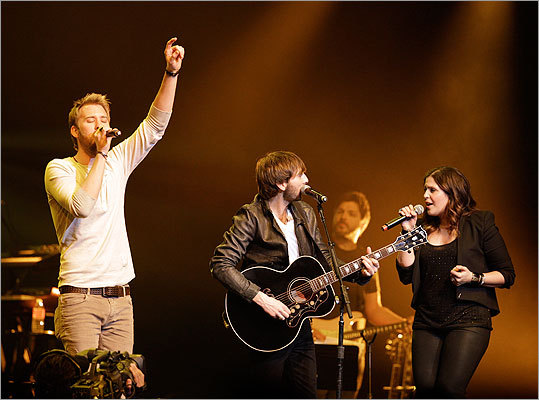 Charles Kelley, left, Dave Haywood, center, and Hillary Scott, of Lady Antebellum, perform during the All for the Hall concert on Tuesday, April 10, 2012,