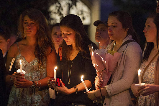 Boston University students and staff members attend a candle light vigil at Marsh Plaza on Boston University Campus in Boston, Massachusetts, May 12, 2012, after the deaths of three students in a car accident abroad in New Zealand.