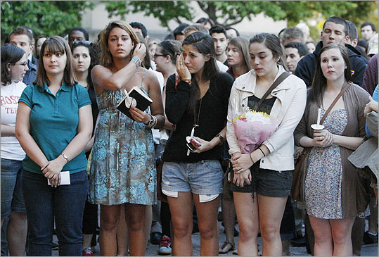 Boston University students held a candlelight vigil on Marsh Plaza at Boston University, on Saturday, May 12, to mourn three students studying in New Zealand who were killed when their minivan crashed during a weekend trip .