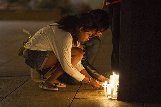Attendees lit candles in remembrance of the three students who were killed. At least five others were injured in the crash.