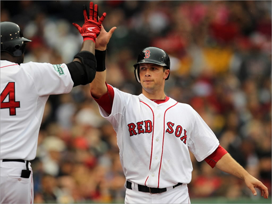 Daniel Nava got congratulated by David Ortiz after scoring in fourth inning.