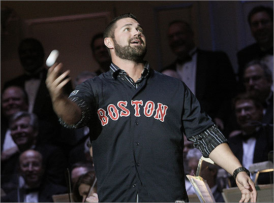 May 24 in Boston Red Sox catcher Kelly Shoppach threw out balls to the audience.