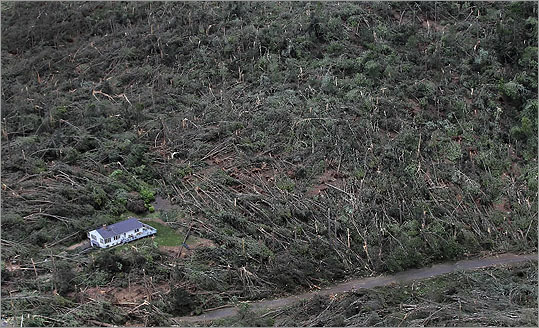 An aerial view of the storm's aftermath showed downed trees around a lone standing home in Brimfield.
