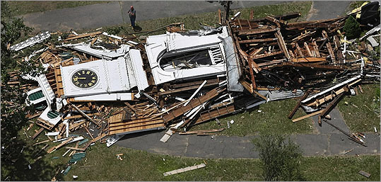 The tornado destroyed long standing buildings including this church steeple in Monson.